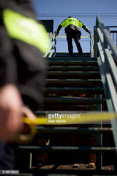 Amtrak police officers tie police tape across the entrance to the Highland Avenue train station near the crash of Amtrak Palmetto train 89 on April 3...