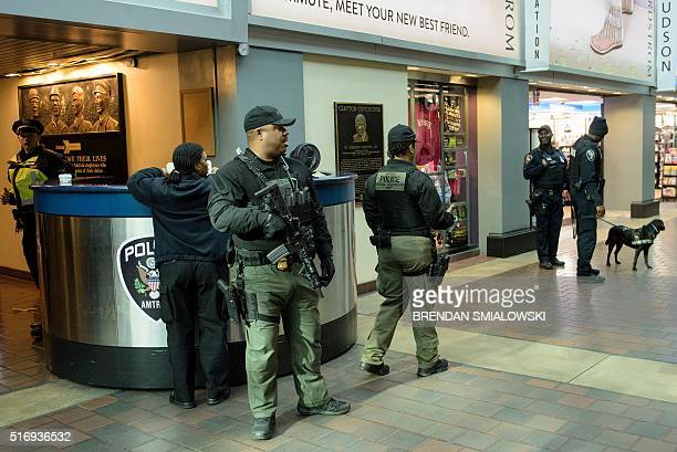 Amtrak police patrol in Union Station March 22 2016 in Washington DC New York and Washington DC stepped up security in the wake of the attacks in...