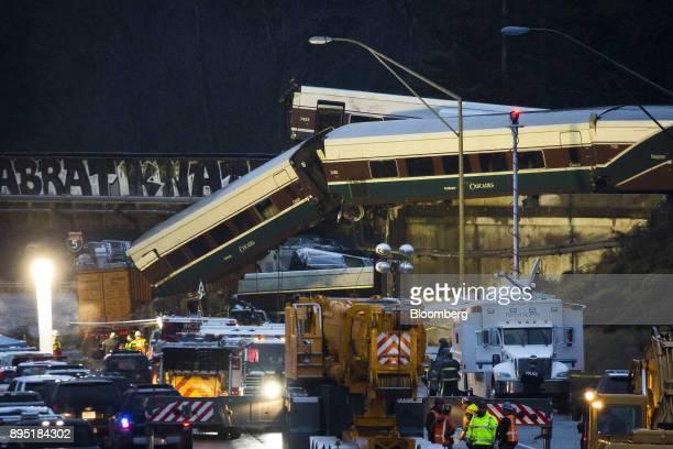 Amtrak train cars lie on Interstate 5 after a derailment in DuPont Washington US on Monday Dec 18 2017 The Amtrak passenger train derailed sending...