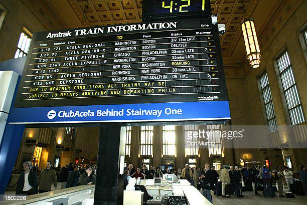 Amtrak train delays coming into and leaving the 30th Street Station are posted for passengers February 18 2003 in Philadelphia The worst blizzard in...