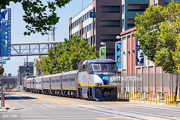 amtrak train on street, jack london square, oakland, california - east bay regional park stock pictures, royalty-free photos & images