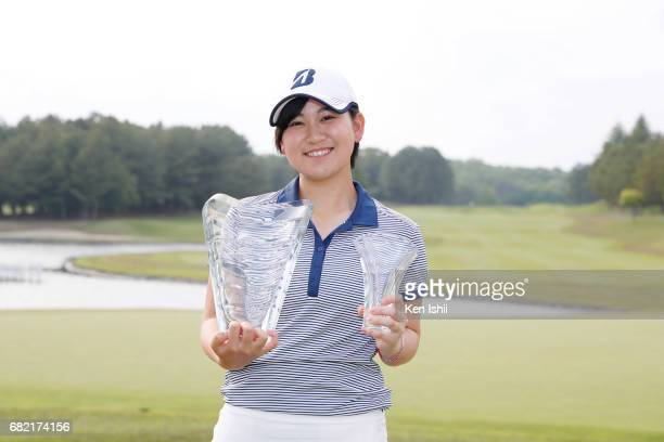 Amu Hiratsuka of Japan holds a winning trophy and a best amateur trophy after winning the final round of the Shizu Hills Mori Building Cup at Shizu...