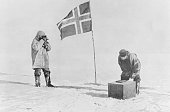 Amundsen expedition proving themselves at the south pole by use of picture id516126526?s=170x170