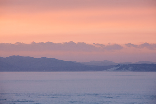 Amur bay in winter with sea ice and sunset in Vladivostok - gettyimageskorea