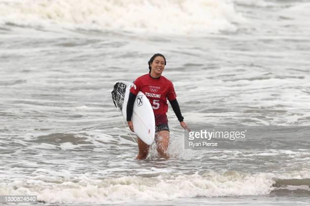 Amuro Tsuzuki of Team Japan shows joy after winning her women's Quarter Final on day four of the Tokyo 2020 Olympic Games at Tsurigasaki Surfing...