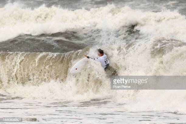 Amuro Tsuzuki of Team Japan surfs in her heat against Carissa Moore of Team United States on day four of the Tokyo 2020 Olympic Games at Tsurigasaki...