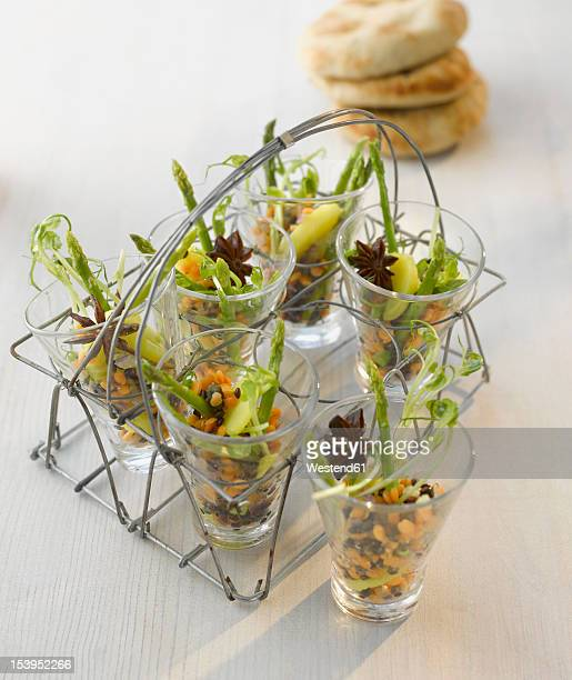 Amuse gueule, lentil salad with asparagus in glass