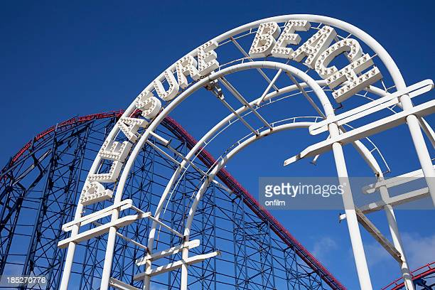 amusement park entrance with rollercoaster - entrance sign stock photos and pictures
