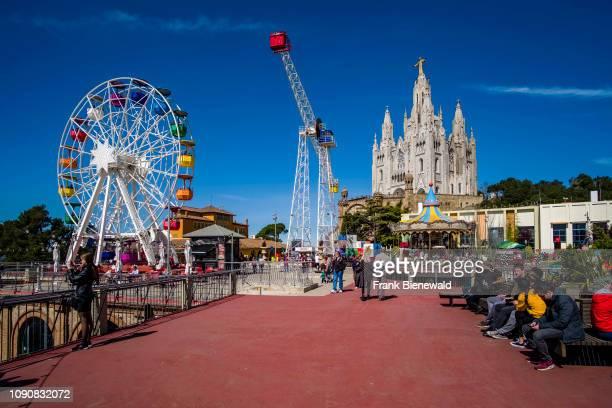 Amusement park in front of Temple Expiatori del Sagrat Cor, Temple of the Sacred Heart of Jesus in Tibidabo.