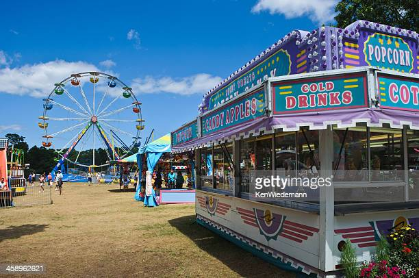 amusement park midway - midway stock photos and pictures