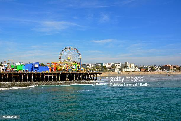 Amusement Park Rides On Santa Monica Pier Against Sky