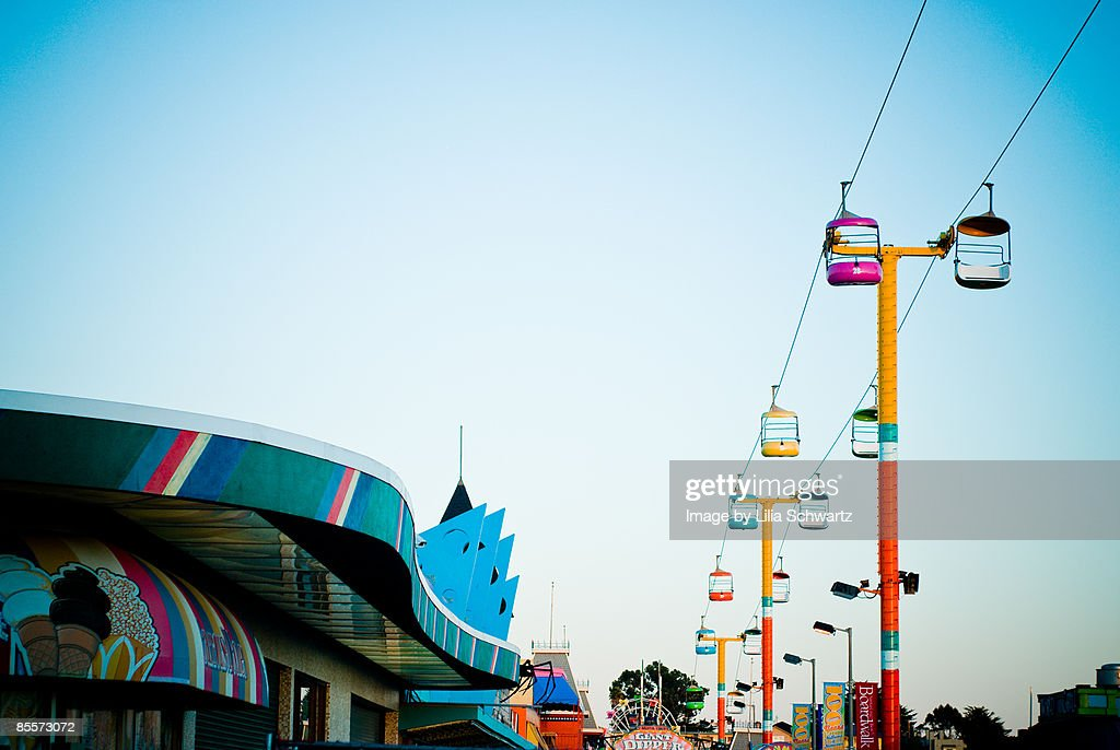 Colourful rides and sky.