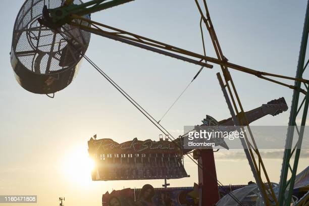 Amusement rides are seen at the Iowa State Fair in Des Moines Iowa US on Thursday Aug 8 2019 The 2020 Democratic field is gathering in Iowa for the...