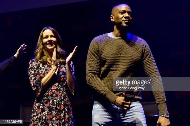 Amy Acker and J. August Richards speak on stage at the Angel - 20th Anniversary panel during New York Comic Con at Hammerstein Ballroom on October...