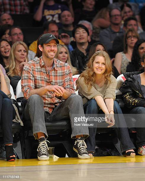 Amy Adams and Darren Le Gallo attend a game between the Utah Jazz and the Los Angeles Lakers at Staples Center on April 5 2011 in Los Angeles...