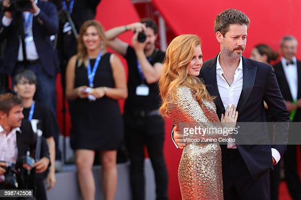 Amy Adams and Darren Le Gallo attend the premiere of 'Nocturnal Animals' during the 73rd Venice Film Festival at Sala Grande on September 2 2016 in...