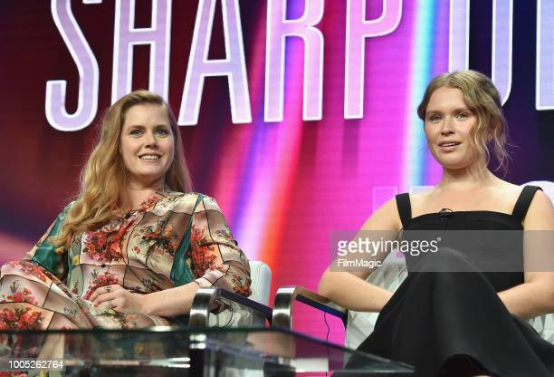 Amy Adams and Eliza Scanion speak onstage at HBO Summer TCA 2018 at The Beverly Hilton Hotel on July 25 2018 in Beverly Hills California