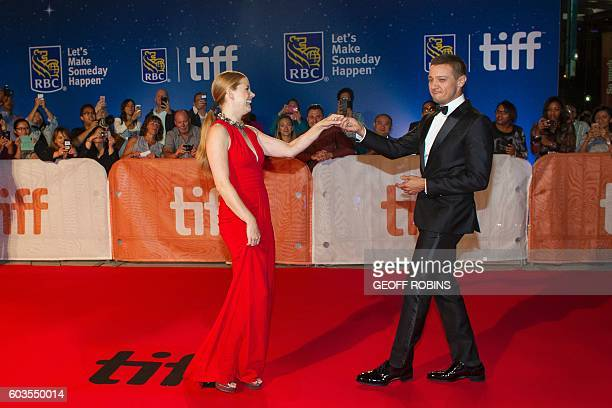 TOPSHOT Amy Adams and Jeremy Renner pose for photographers during the premiere of 'Arrival' at the Toronto International Film Festival in Toronto...