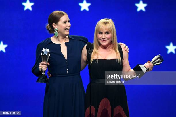 Amy Adams and Patricia Arquette cowinners of the Best Actress in a Limited Series or Movie Made for Television award accept their awards onstage...