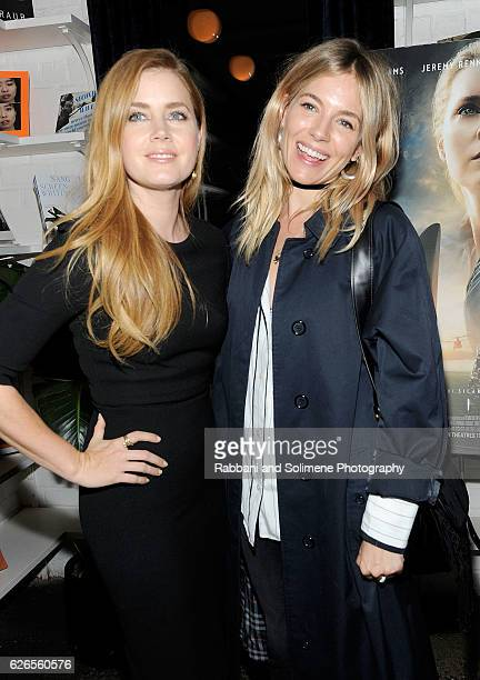 Amy Adams and Sienna Miller attend Spike Jonze The Cinema Society Host A Screening Of Paramount Pictures' 'Arrival' at The Metrograph on November 29...