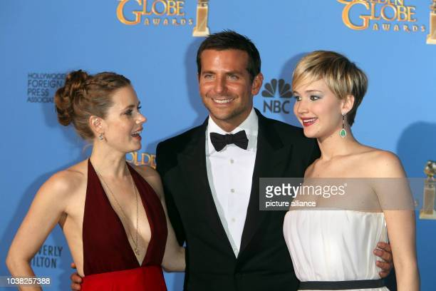 Amy Adams Bradley Cooper and Jennifer Lawrence pose in the press room of the 71st Annual Golden Globe Awards aka Golden Globes at Hotel Beverly...