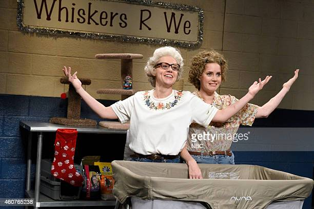 LIVE Amy Adams Episode 1672 Pictured Kate McKinnon as Barbara Dedrue and Amy Adams as Ashley during the Cat Rescue Commercial skit on December 20 2014