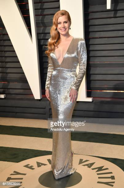Amy Adams poses as she arrives at the Vanity Fair Oscar Party in Beverly Hills California Los Angeles on February 27 2017