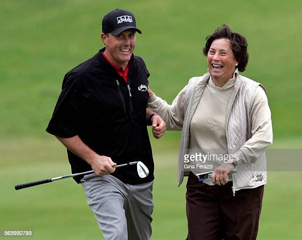 Amy Alcott congratulates gives Phil Mickelson after he landed a tough chip shot 3 feet from the pin on 2nd hole during the Northern Trust Open PGA...