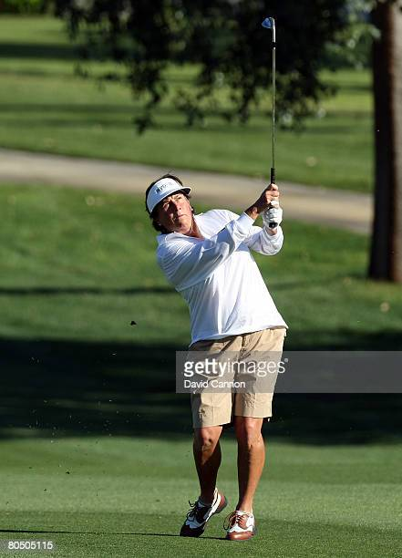 Amy Alcott hits her third shot at the second hole during the first round of the Kraft Nabisco Championship at the Mission Hills Country Club April 3...