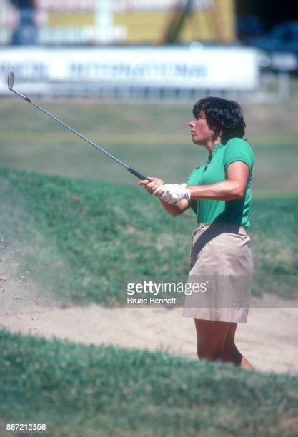 Amy Alcott of the United States hits her shot out of the bunker during the 1980 WUI Classic on July 27 1980 at Meadow Brook Club in Jericho New York