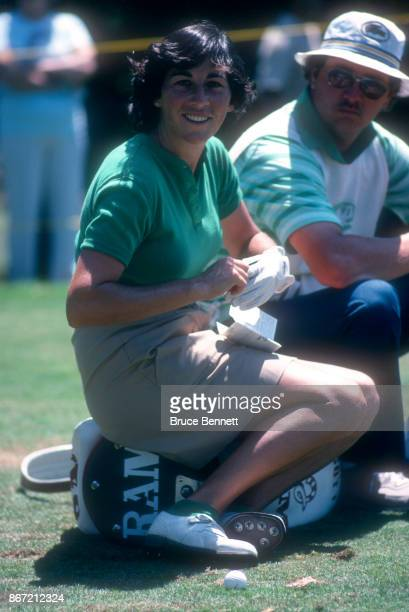 Amy Alcott of the United States sits on her golf bag with her caddie during the 1980 WUI Classic on July 27 1980 at Meadow Brook Club in Jericho New...