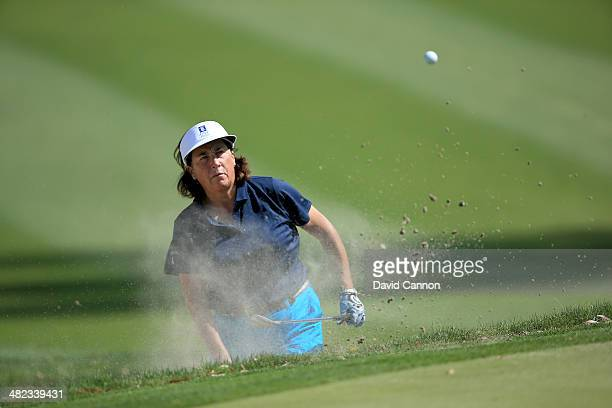 Amy Alcott of the USA plays her fourth shot at the par 5 11th hole during the first round of the 2014 Kraft Nabisco Championship on the Dinah Shore...