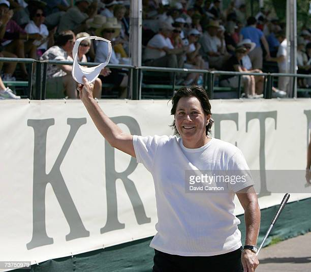 Amy Alcott of the USA salutes the fans as she walks to the green at the par 5 18th hole during the second round of the 2007 Kraft Nabisco...