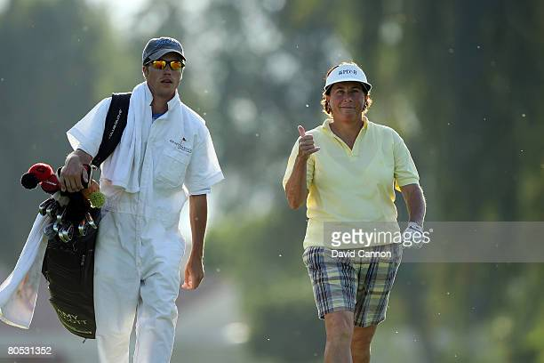 Amy Alcott of the USA walks happily down the 9th fairway on the way to finishing her last round in the tournament after 35 years at the end of her...