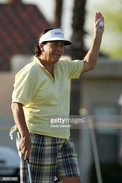 Amy Alcott of the USA waves to the crowd after finishing her last round in the tournament after 35 years at the end of her second round of the Kraft...