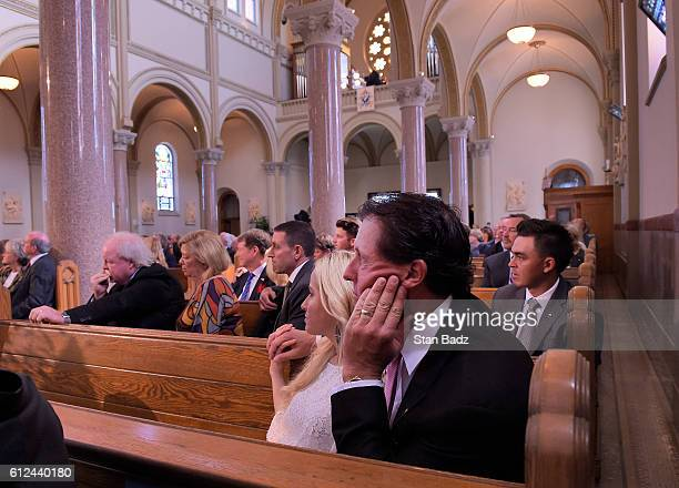 Amy and Phil Mickelson listen to remarks during he Celebration of the Life and Legacy of Arnold Palmer at the Vincent Basilica on the campus of Saint...