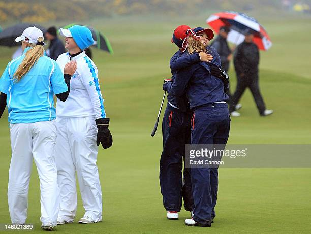 Amy Anderson and Tiffany Lua of the United States celebrate after winning their match aginst Charley Hull and Pamela Pretswell of Great Britain and...
