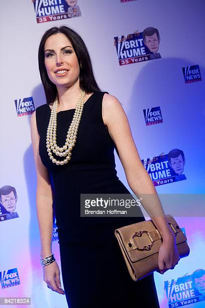 Amy Baier wife of FOX News Channel host Bret Baier poses on the red carpet upon arrival at a salute to FOX News Channel's Brit Hume on January 8 2009...