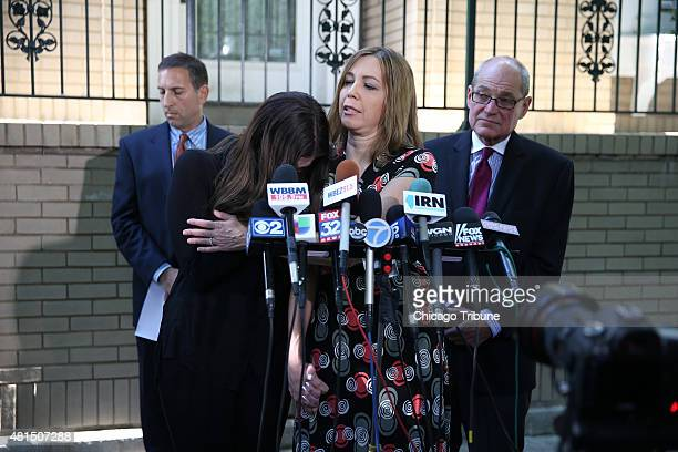 Amy Blagojevich left reacts as her mother Patti Blagojevich speaks during a news conference on Tuesday July 21 following the announcement of a...