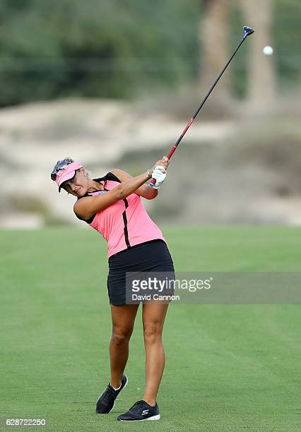 Amy Boulden of Wales plays her second shot at the 14th hole during the delayed second round of the 2016 Omega Dubai Ladies Masters on the Majlis...