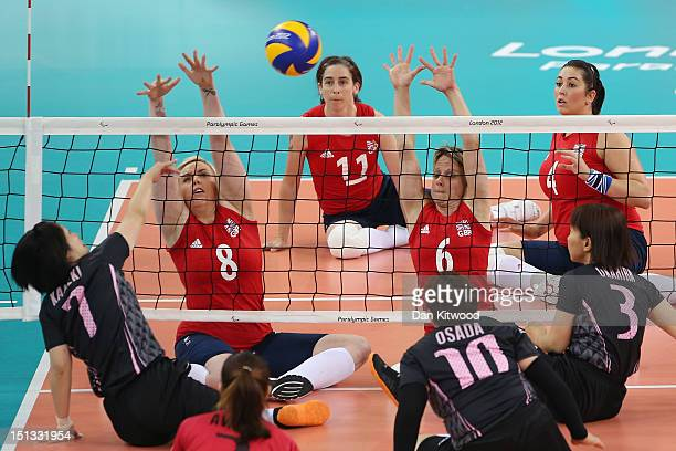 Amy Brierly and Emma Wiggs of Great Britain reach up to block a shot during the Women's Sitting Volleyball 78 Clasification match against Japan on...