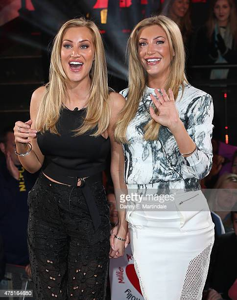 Amy Broardbent and Sally Broardbent leave the Big Brother Timebomb house at Elstree Studios on May 12 2015 in Borehamwood England