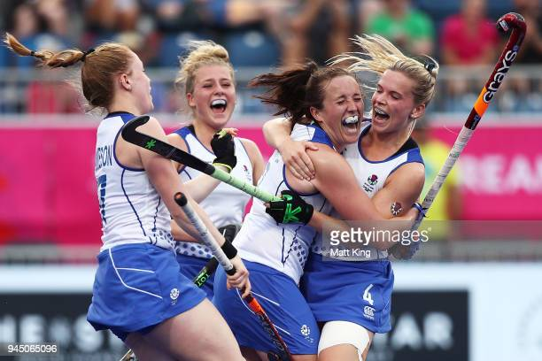 Amy Brodie of Scotland celebrates with team mates after scoring a goal during Women's Placing 78 Hockey match between Malaysia and Scotland on day...