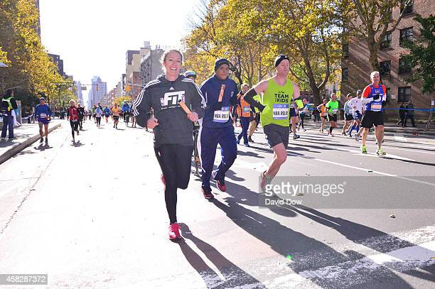 Amy Brooks runs her leg in the 2014 NBA AllStar Relay during the TCS NYC Marathon on November 2 2014 in New York City NOTE TO USER User expressly...