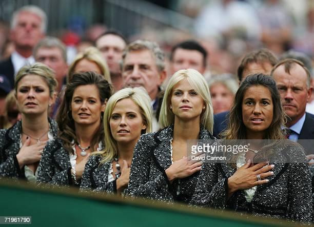 Amy Campbell Tabitha Furyk Amy Mickelson Elin Woods and Melissa Lehman observe their country's national anthem during the Opening Ceremony of the...