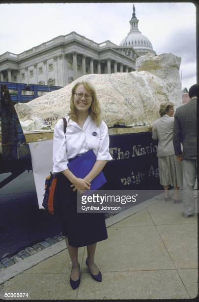 Amy Carter daughter of President Carter alone in front of Capitol with giant papier mache foot for House Select Committee on hunger regarding Hands...