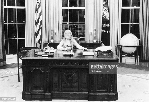 Amy Carter sits at the president's desk in the Oval Office in a picture taken by her brother Jeff