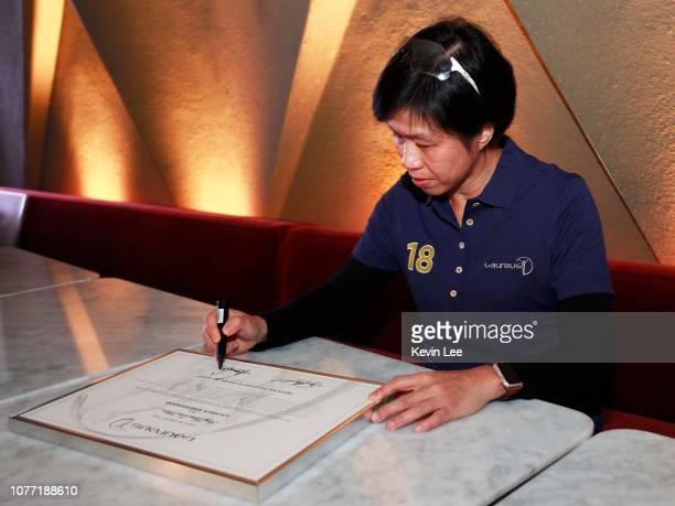 Amy Chan Lim Chee signs the certificate before the Laureus Hong Kong Ambassador Announcement ceremony at Mercedes Me Store on December 04 2018 in...