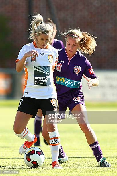 Amy Chapman of the Roar and Alyssa Mautz of the Glory contest for the ball during the round two WLeague match between the Perth Glory and Brisbane...