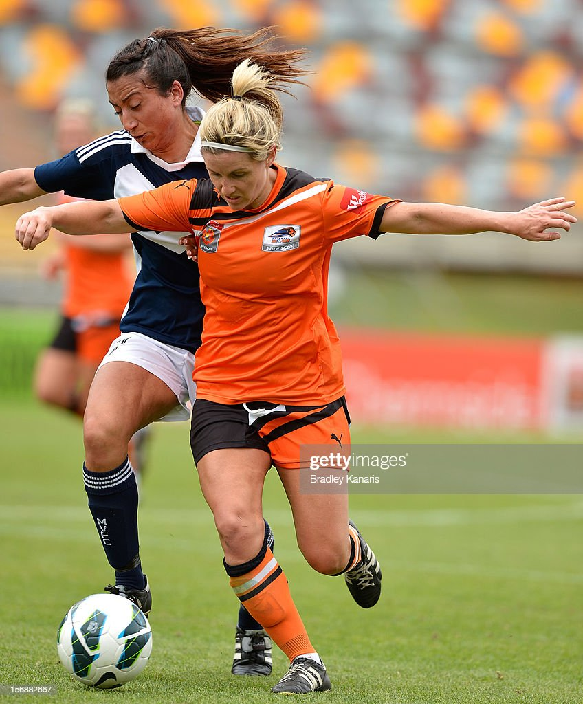 Amy Chapman of the Roar is challenged by the defence during the round six W-League match between the Brisbane Roar and the Melbourne Victory at the Queensland Sport and Athletics Centre on November 24, 2012 in Brisbane, Australia.